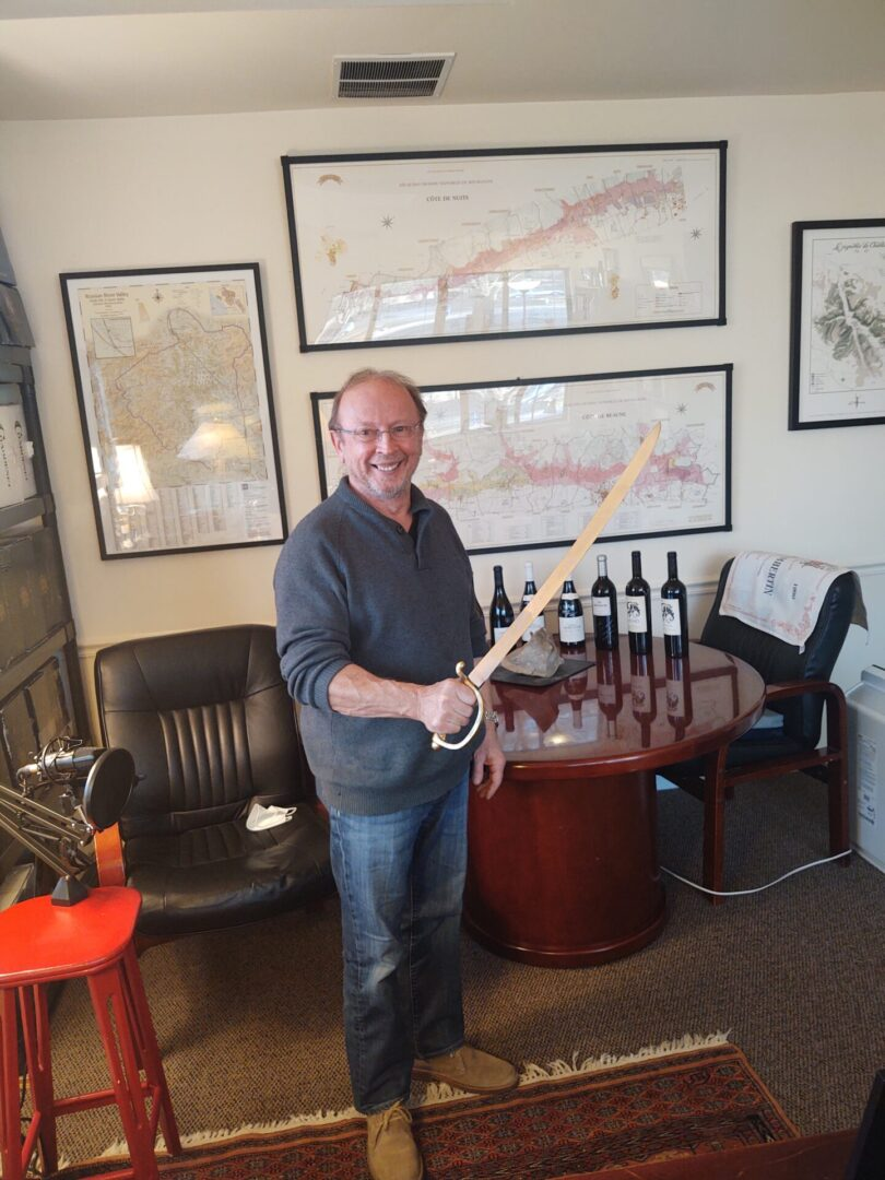 Episode #13, Thibaut-Janisson: Claude Thibaut ready to Saber a bottle of Sparkling Wine.